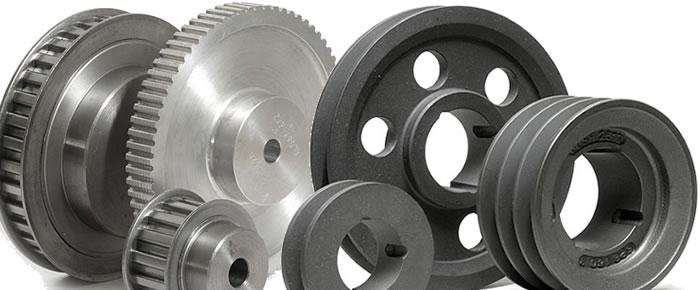 Pulegge di trasmissione in diverse forme in base alla tipologia di cinghia utilizzata.
